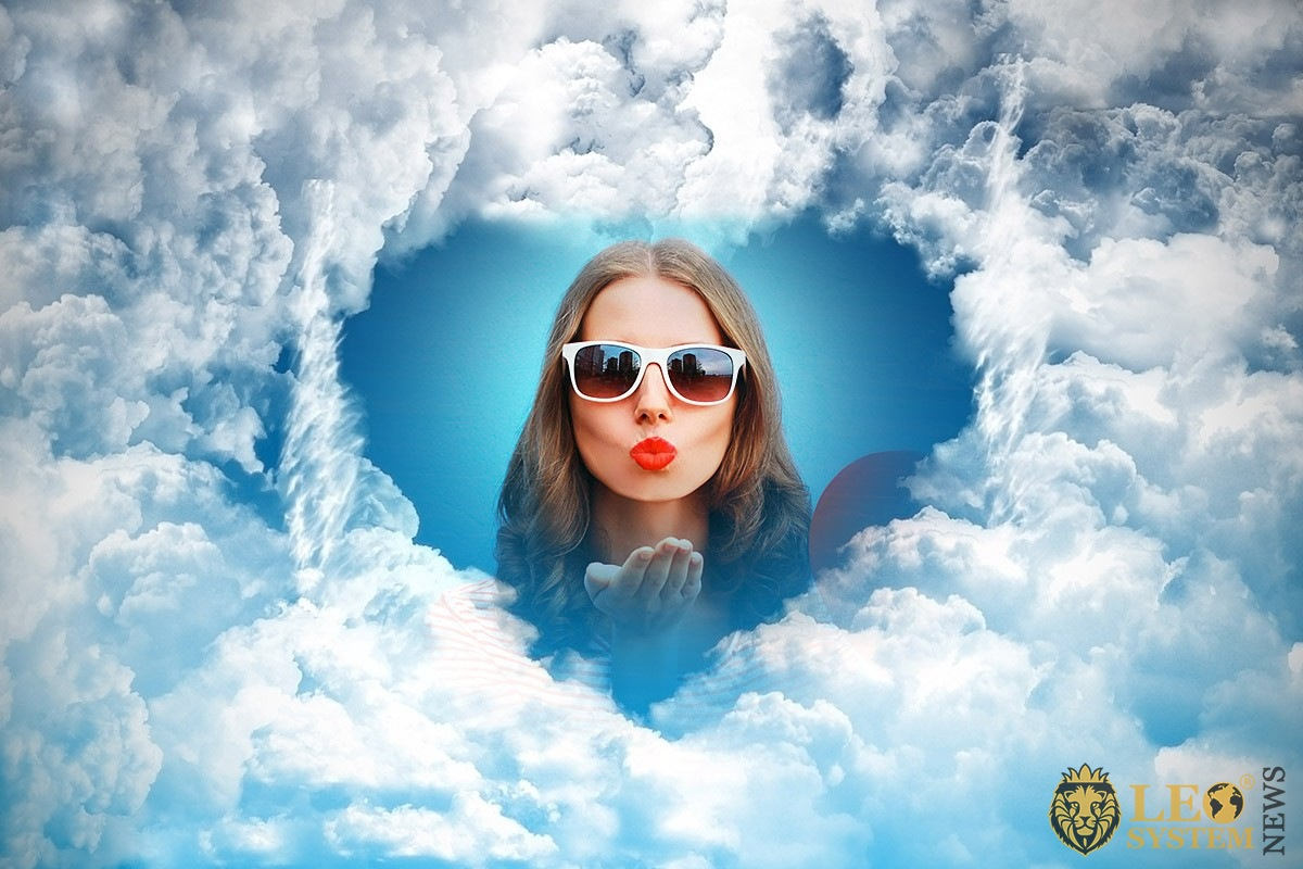 Image of clouds in the form of a heart and in the center the face of a girl
