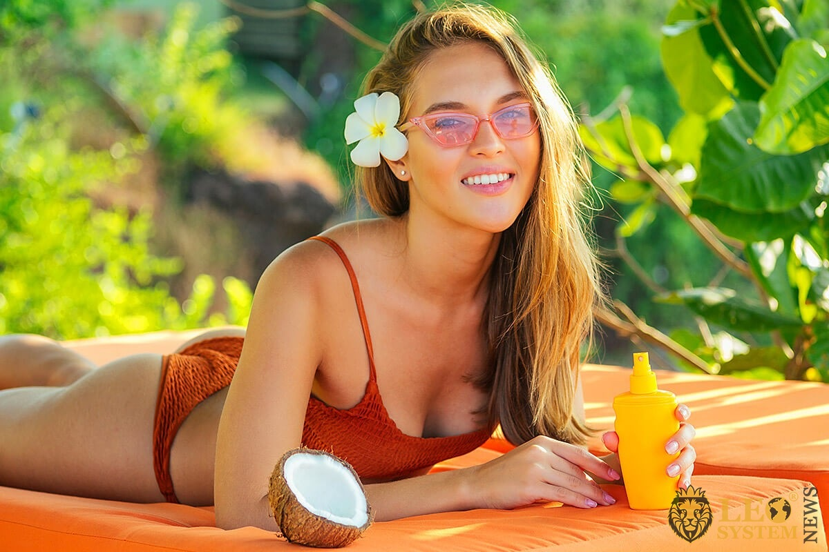 Nice girl with coconut