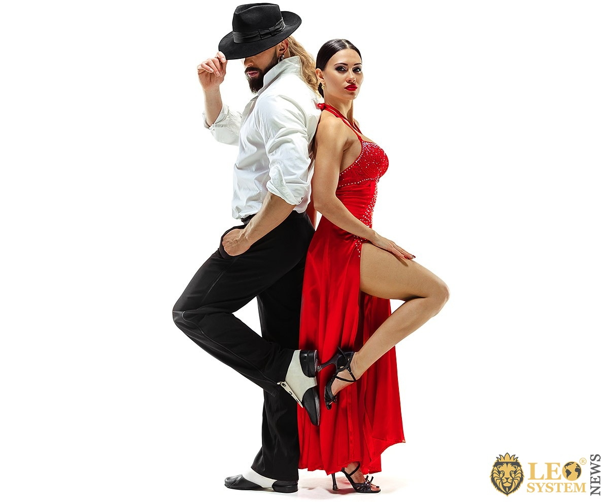 Image of a dancing man in a hat and a woman in an evening dress