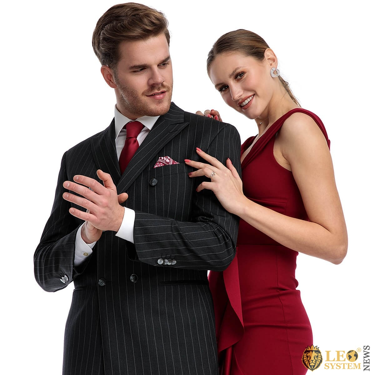 Attractive man in a suit with a pretty woman in a beautiful red dress