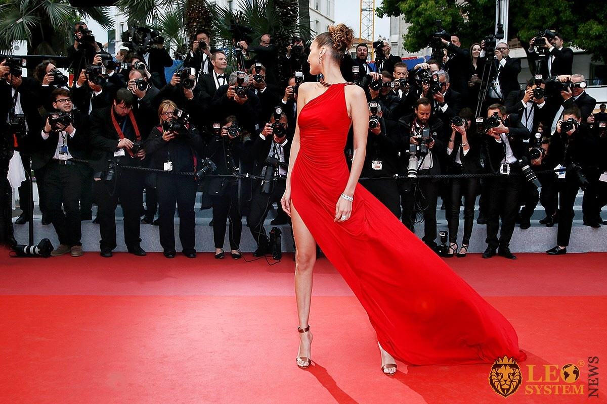 American model Bella Hadid on the red carpet in a red dress