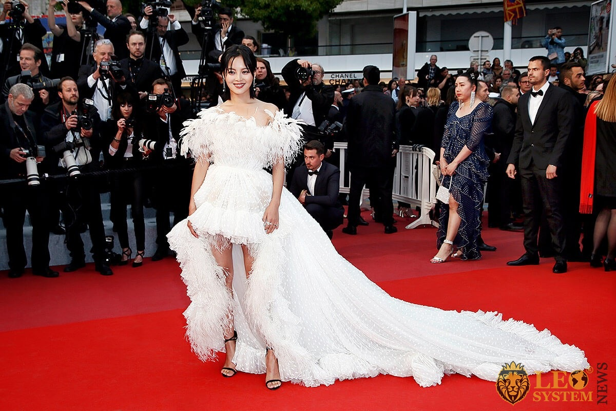 Chinese actress Xin Zhilei on the red carpet in a white dress