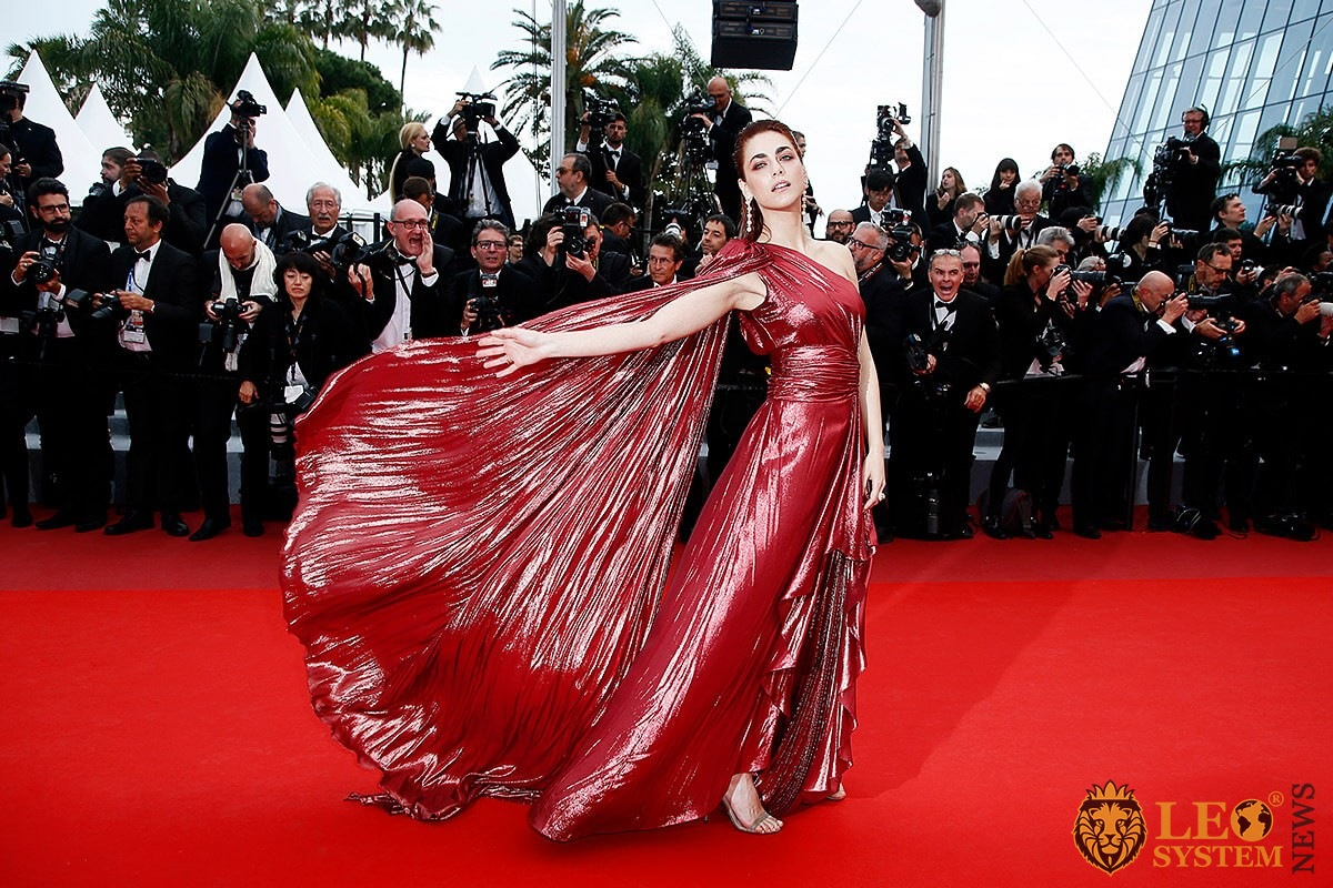Italian actress Miriam Leone in a burgundy puffy dress on the red carpet