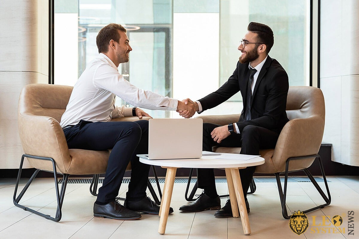Friendly handshake of business people