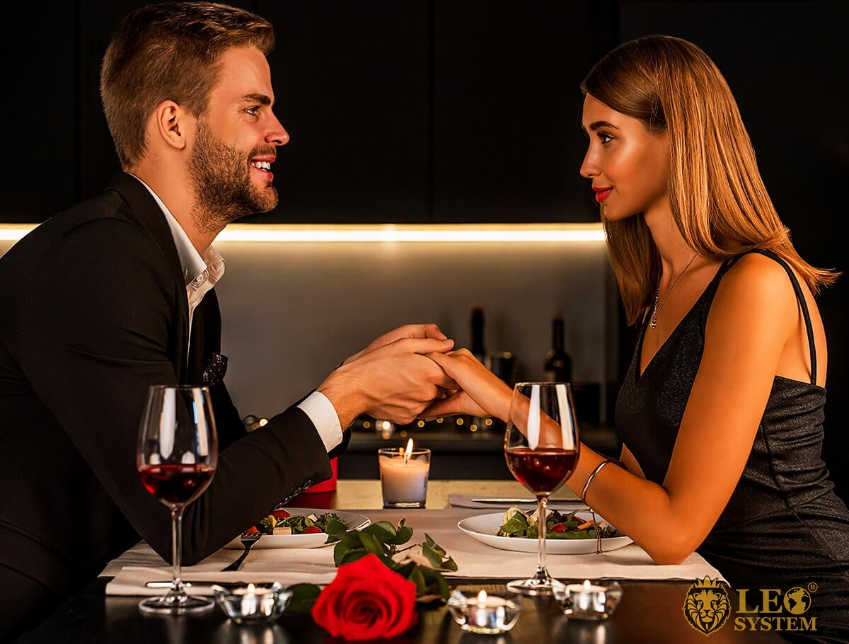 Young man and girl meet in a restaurant
