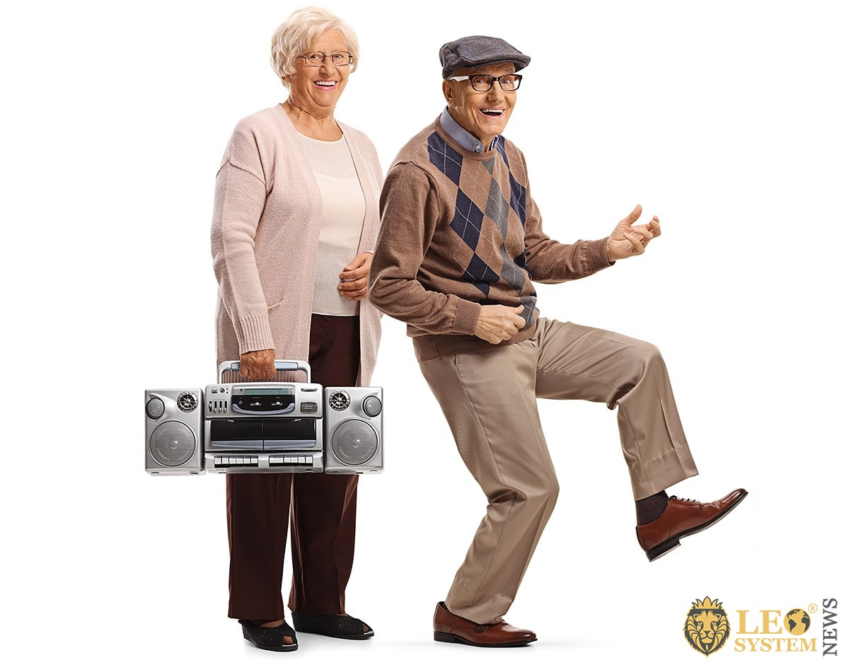 Fun elderly couple with a tape recorder