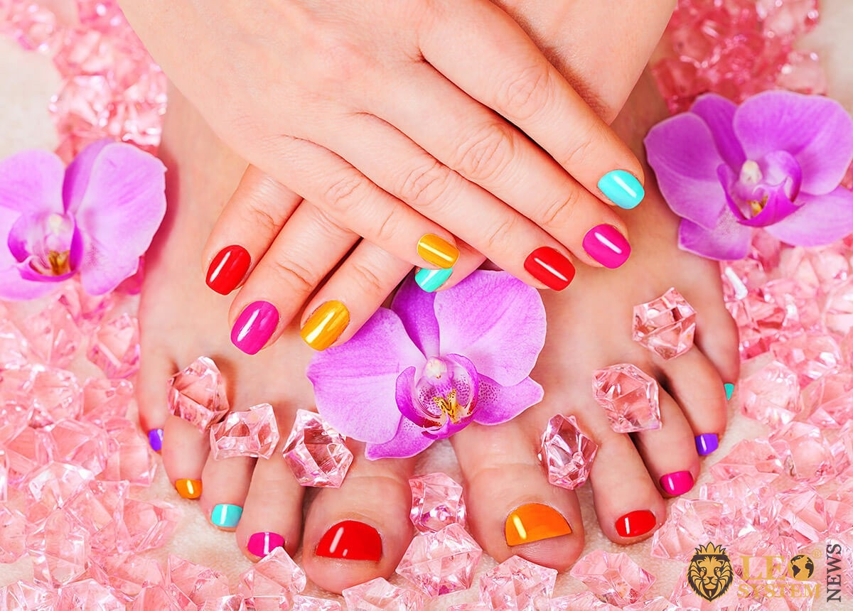 Multicolored pedicure and flowers