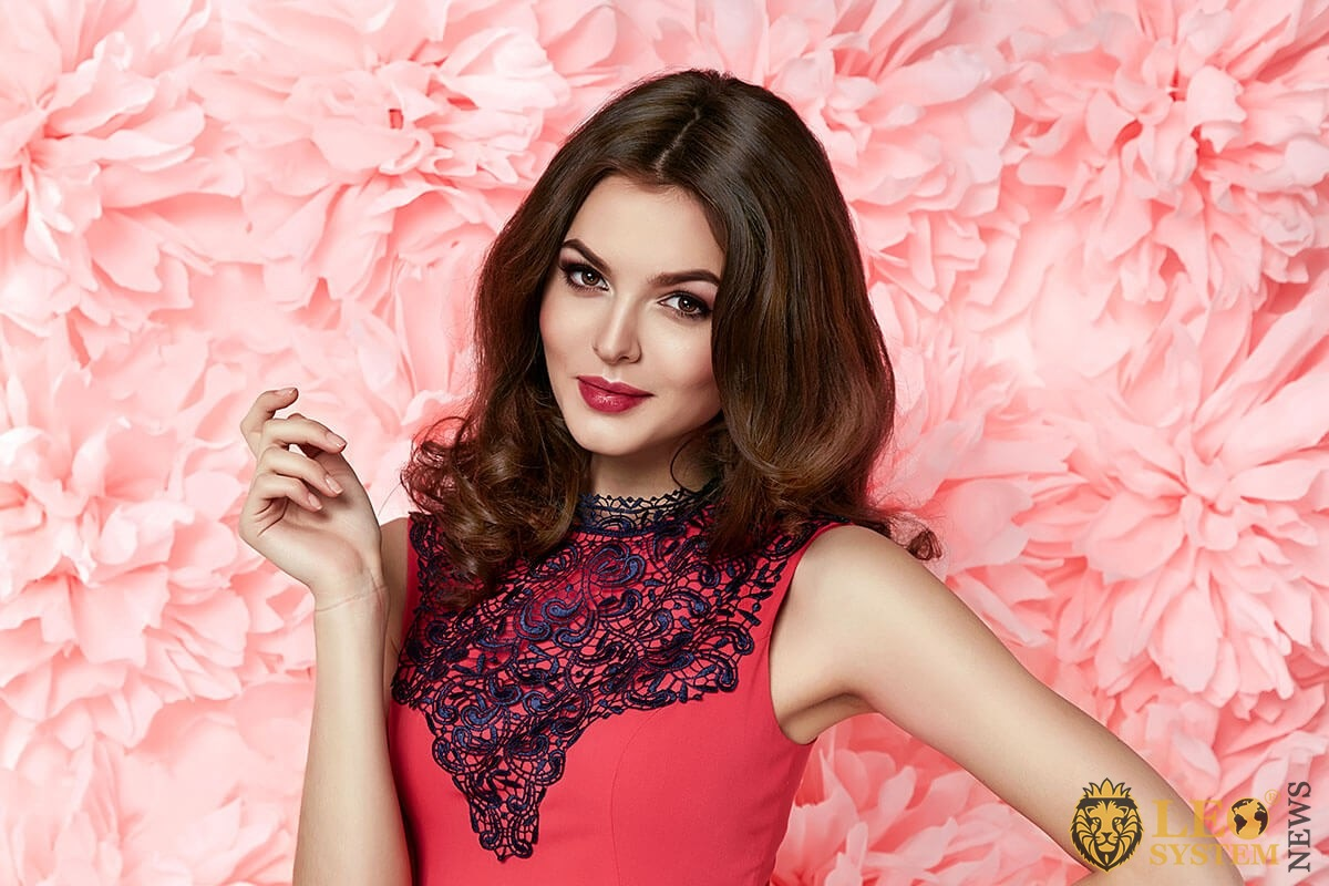 Nice girl on a background of pink flowers