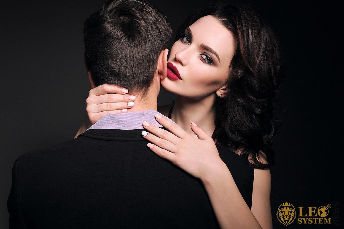 Charming woman hugs her jealous man