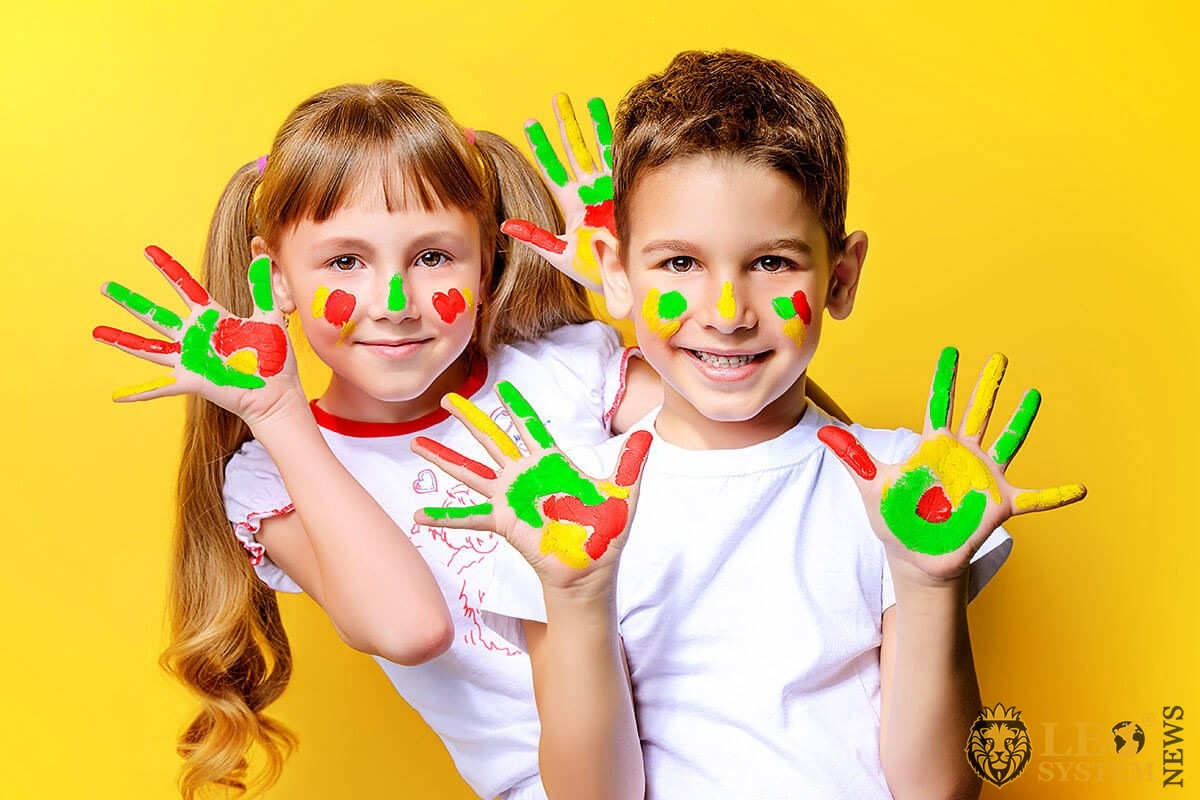 Image of children playing with paint