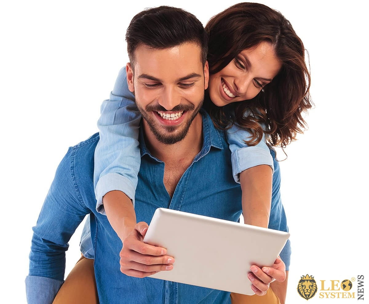 Young couple studying psychology on a tablet