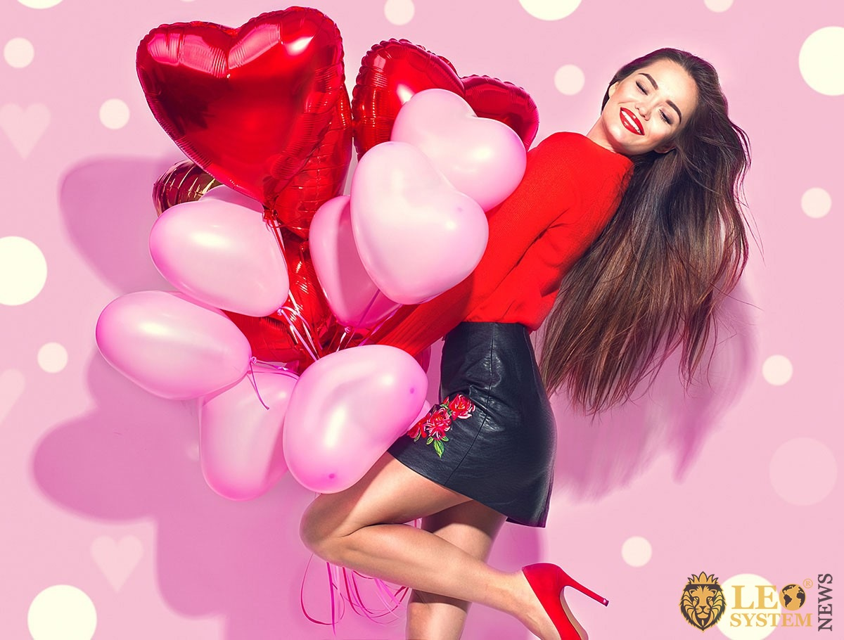 Beautiful girl with balloons in the form of hearts