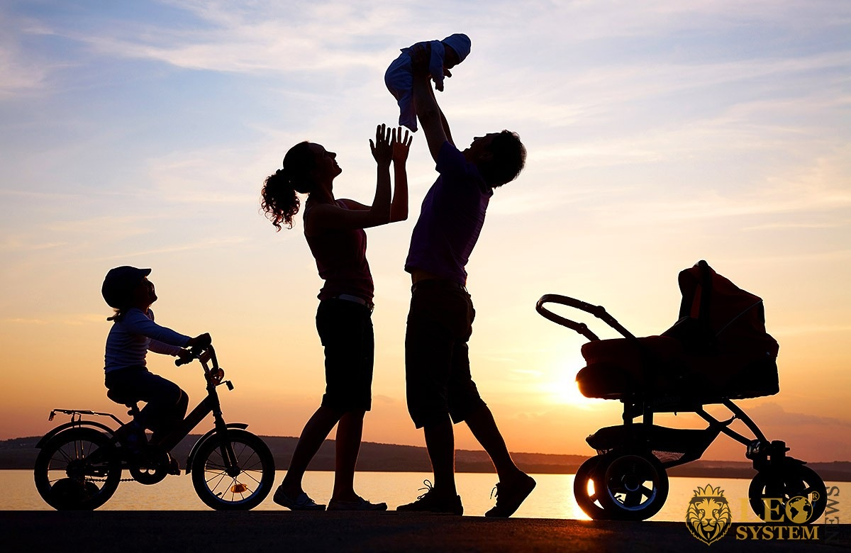 Image of parents with their children at sunset