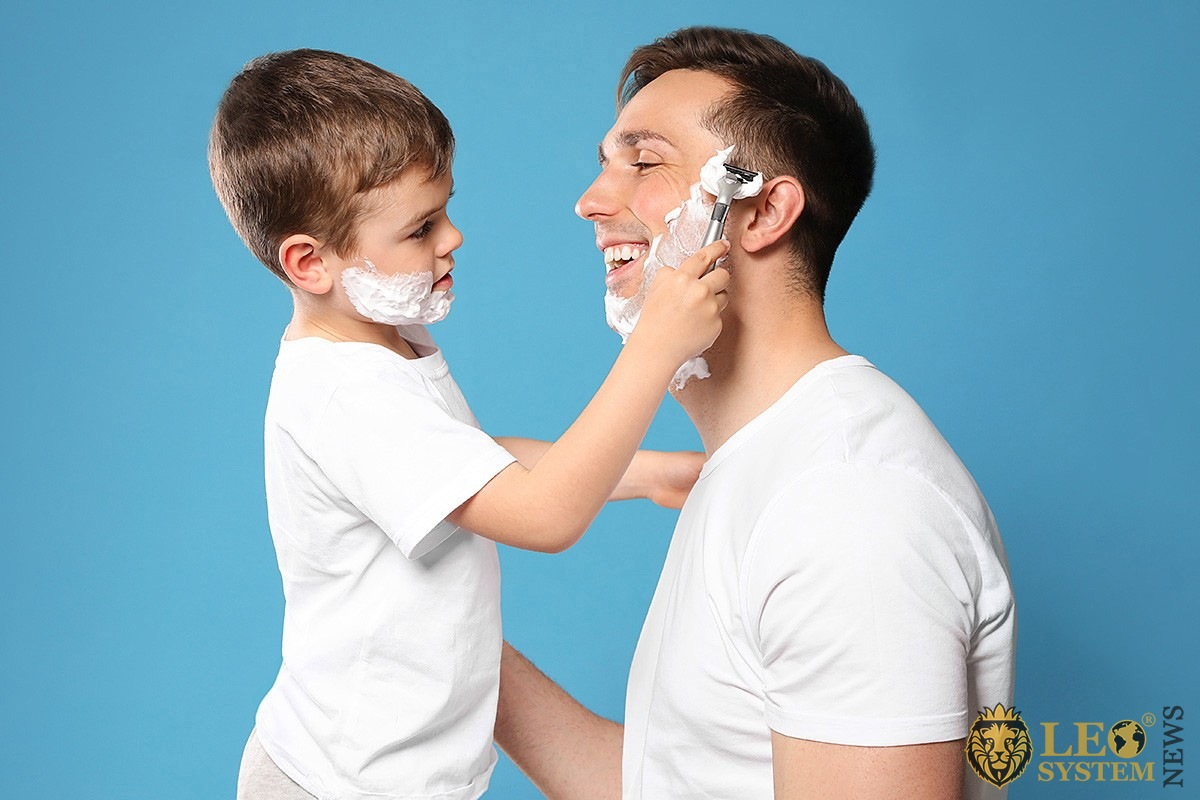 Image of son and father shaving together
