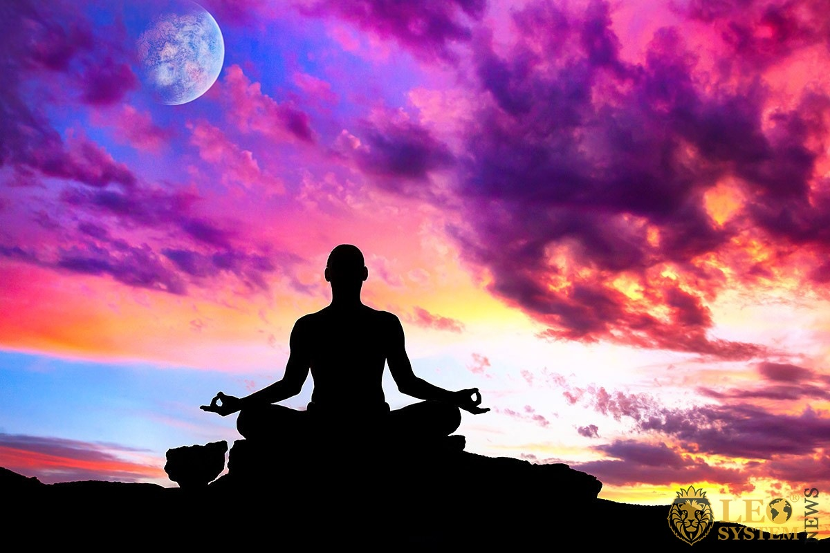 Image of a man meditating at sunset