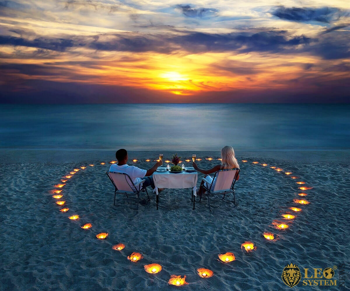 Romantic evening dinner of a married couple by the sea