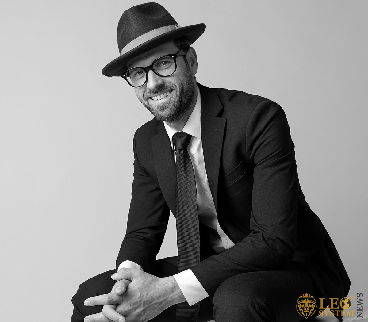 Jealous man in a business suit, hat and glasses