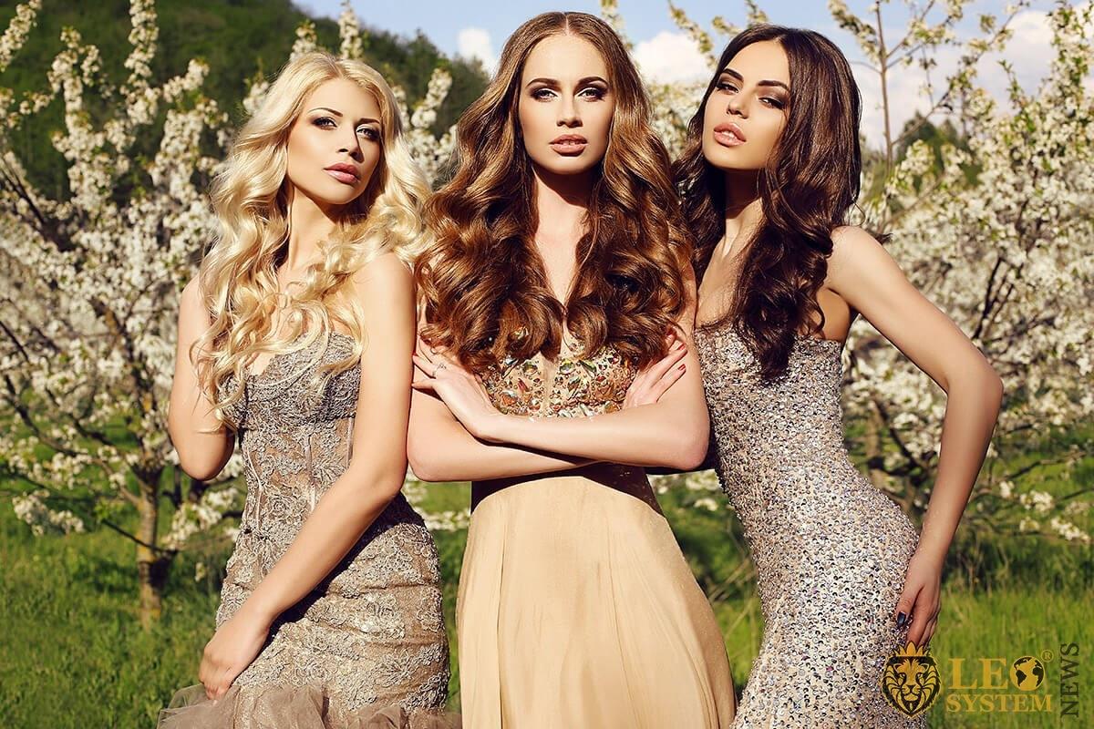 Image of three gorgeous ladies in beautiful dresses