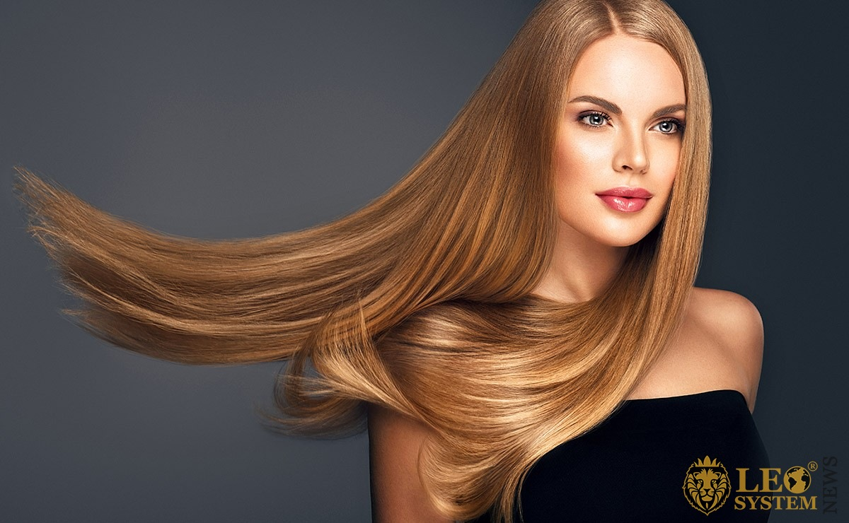 Beautiful woman with long and well-groomed hair