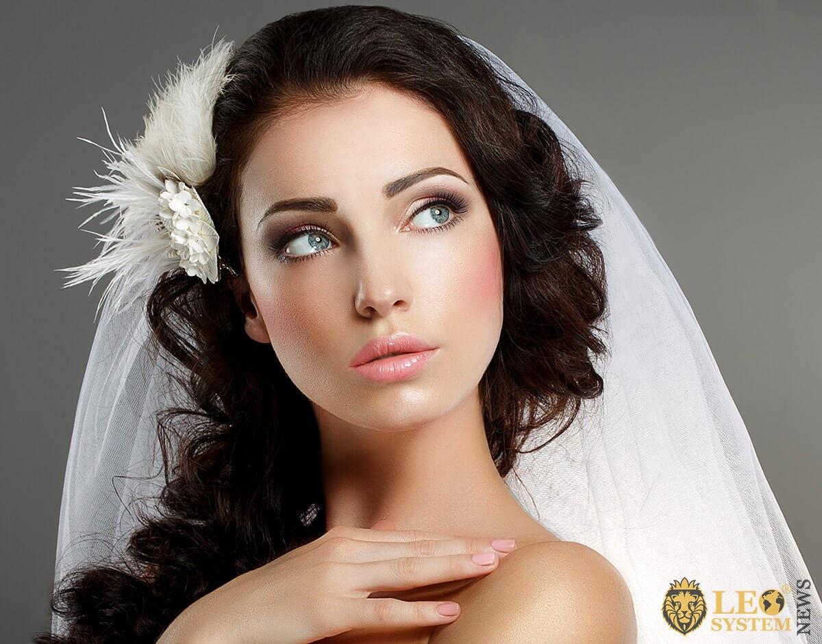 Delightful bride looks with tender eyes