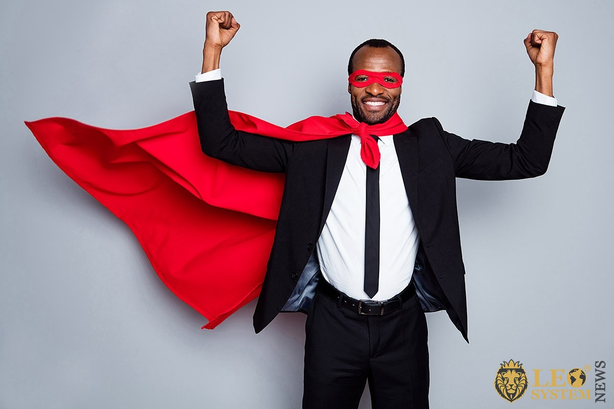 Husband in red superman cape and mask