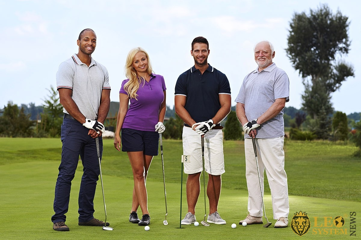 Image of a friendly team playing golf