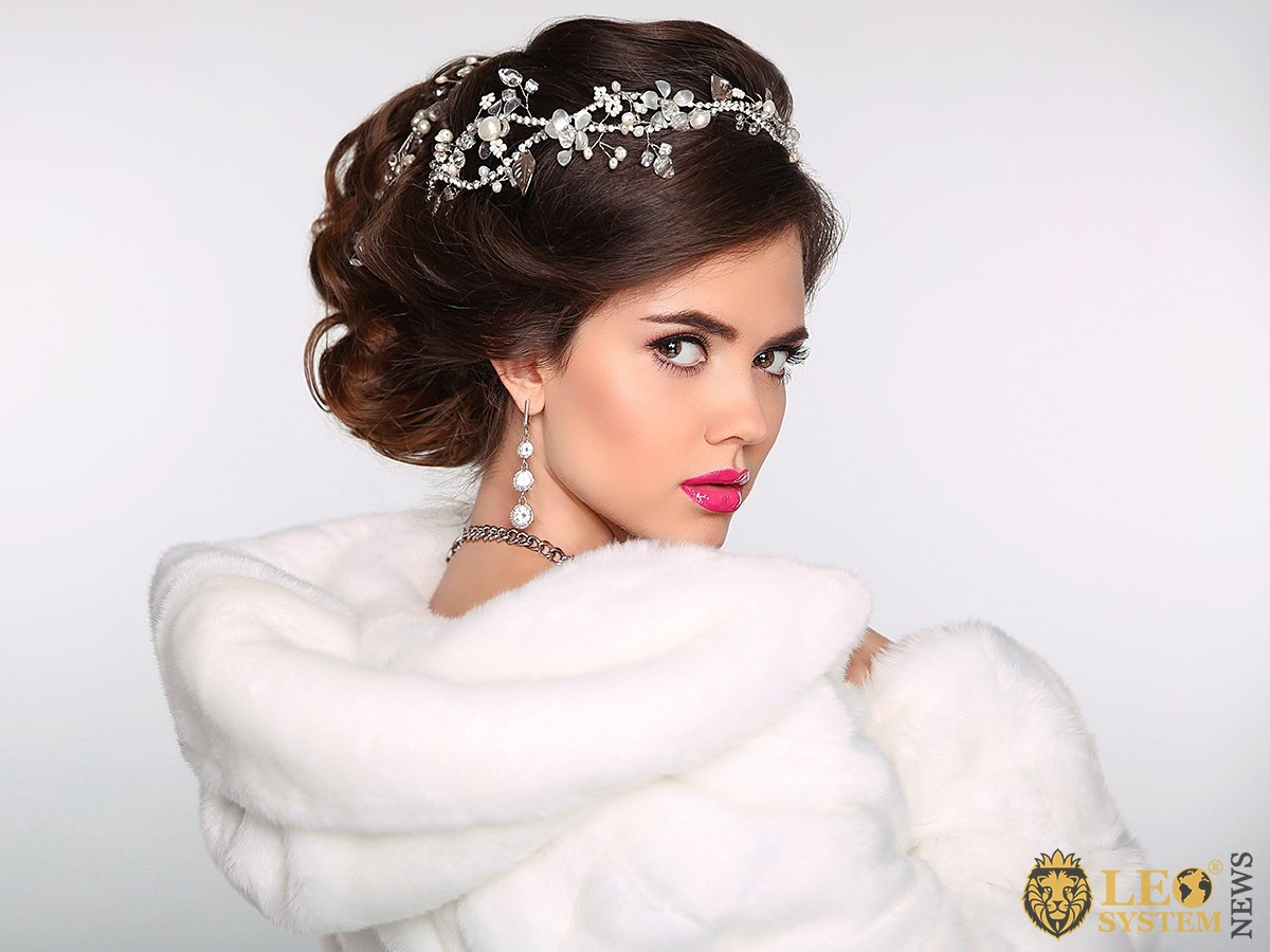 Image of a bride with styled hair and attractive makeup