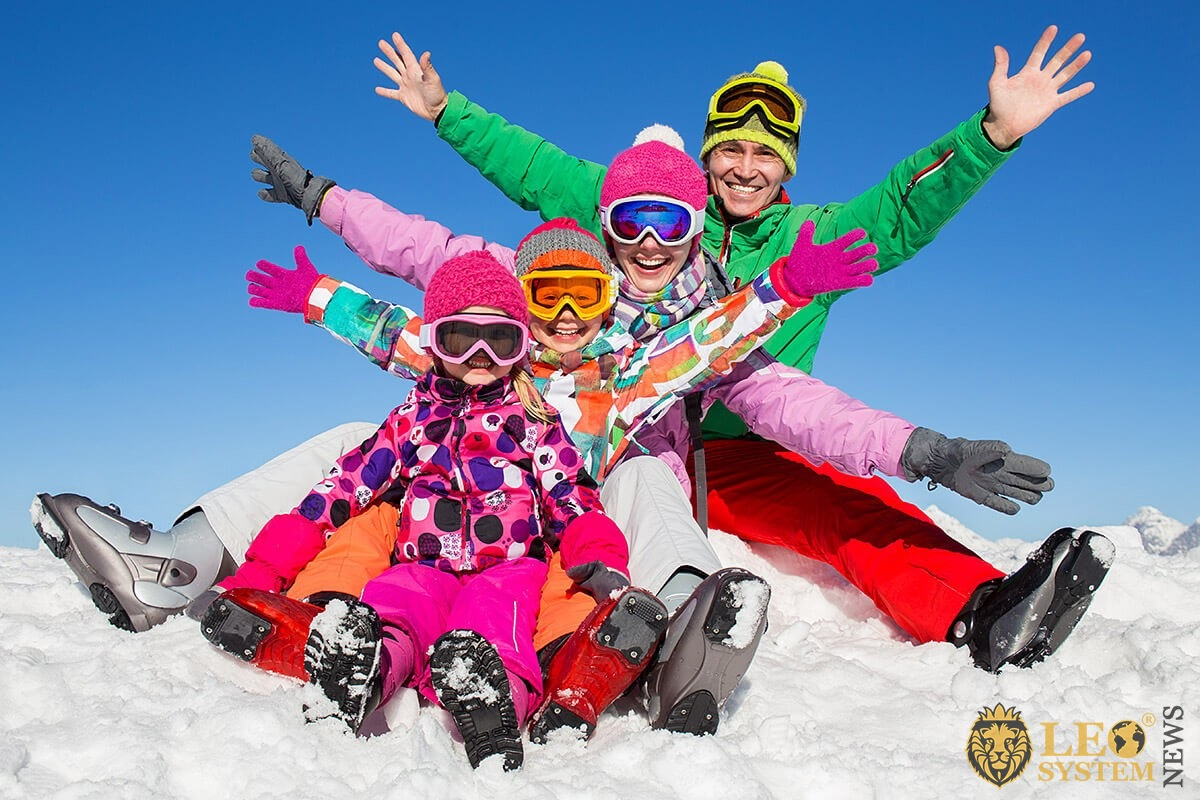 Image of parents and children in ski uniforms