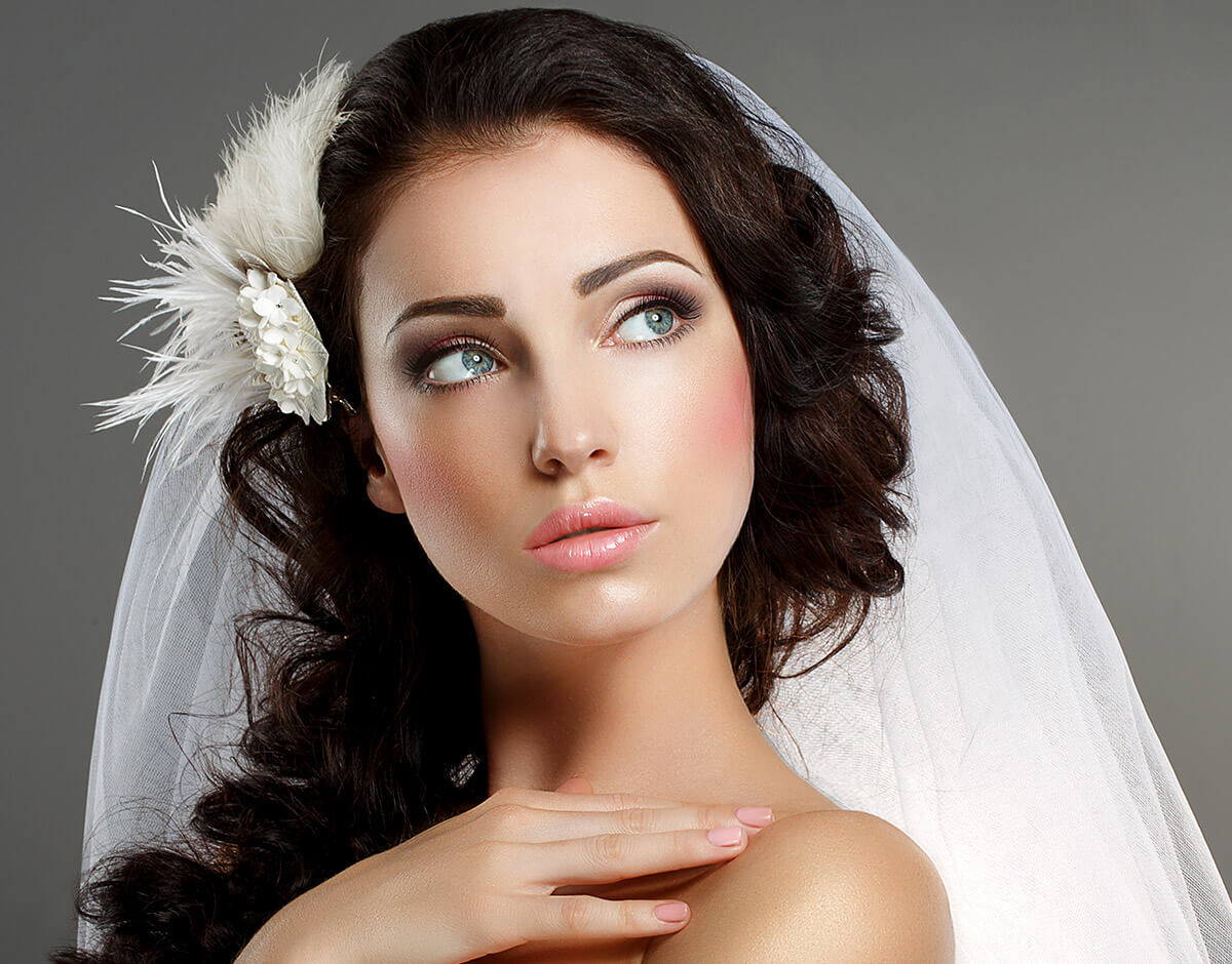 Delightful bride looks with tender eyes