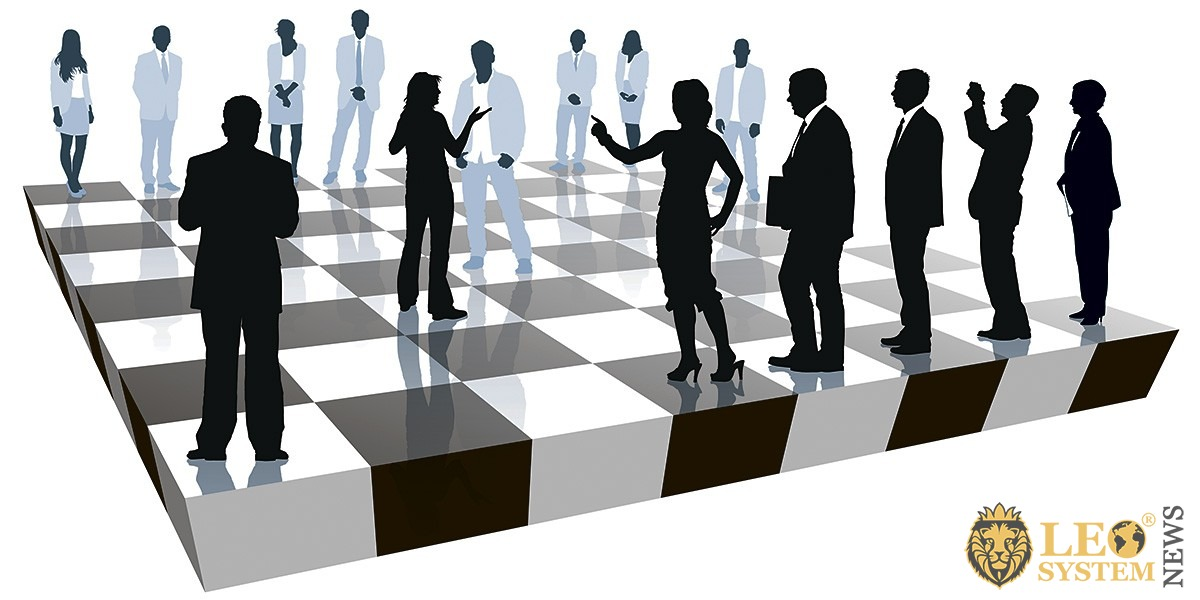 Image of figures of people on a chessboard