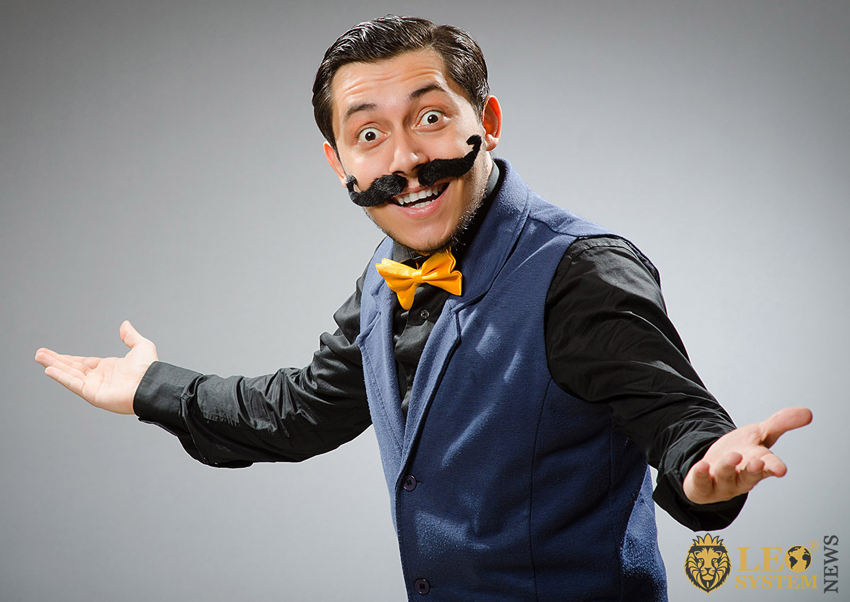Funny man in bow tie and pasted mustache
