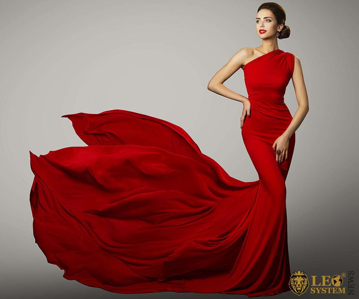 Beautiful woman in a lush red dress