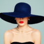 Pretty woman with red lipstick and a big hat