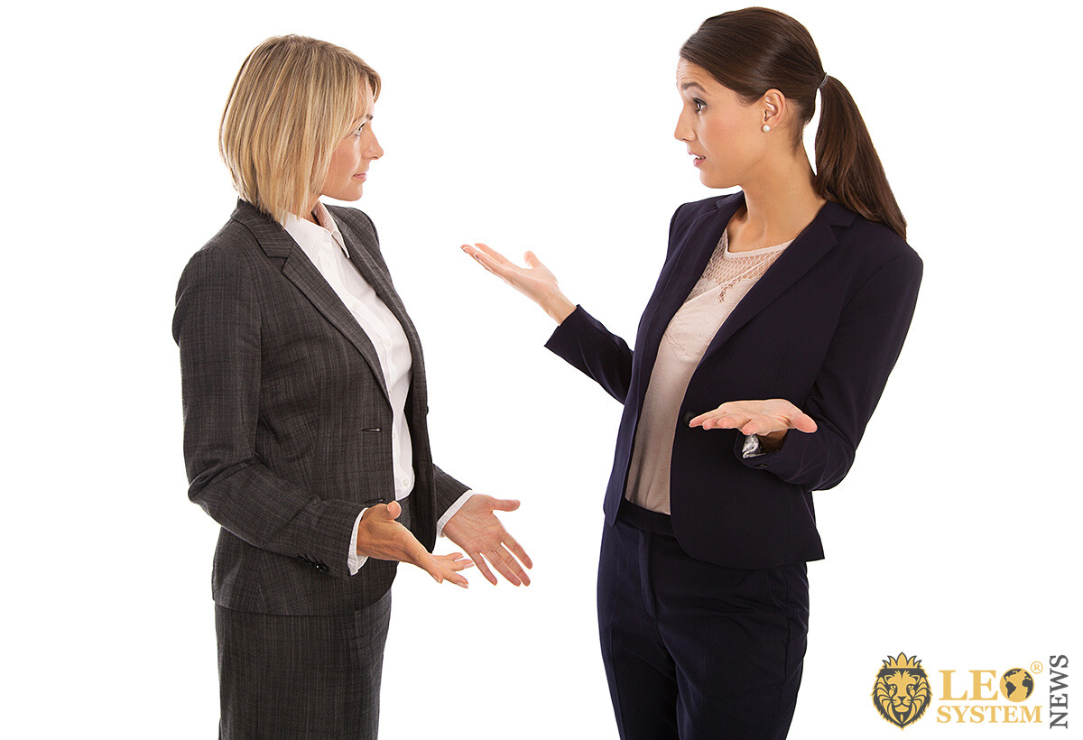 Image of two women talking in raised tones