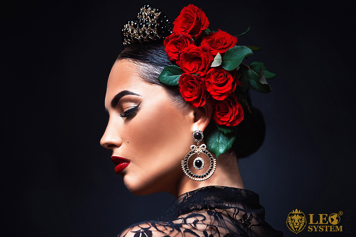 Image of a proud woman with red flowers in her hair