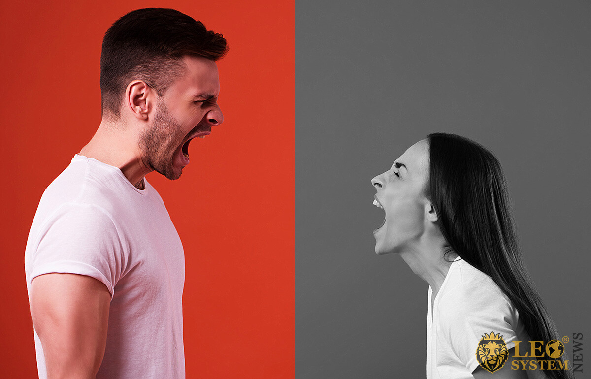 Emotional man and woman quarreling with each other