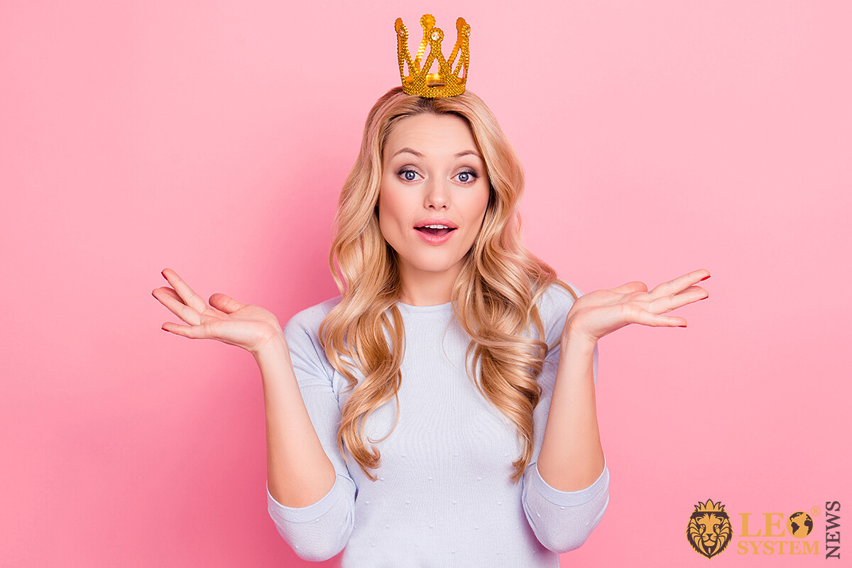 Image of a joyful woman with a crown on her head