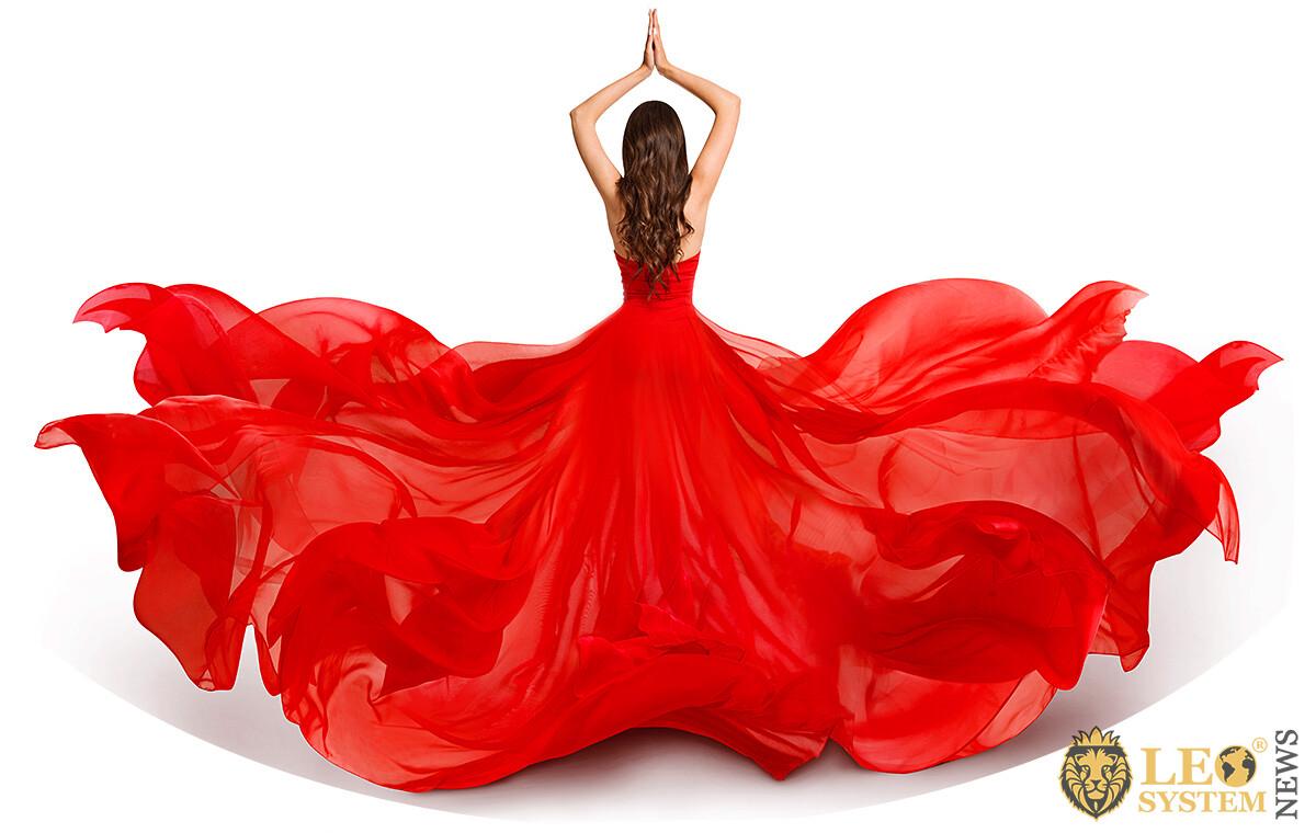 Cute girl in red puffy dress