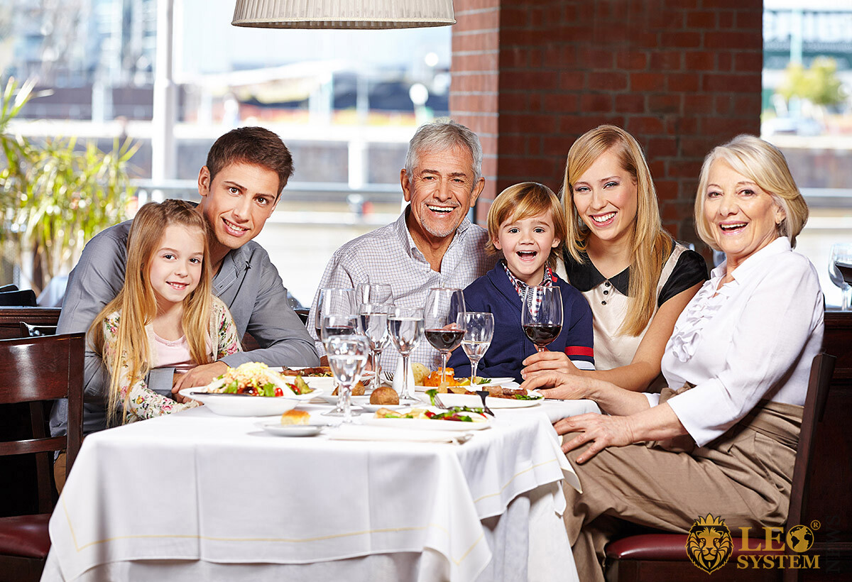 Joyful family at a festive table in a restaurant