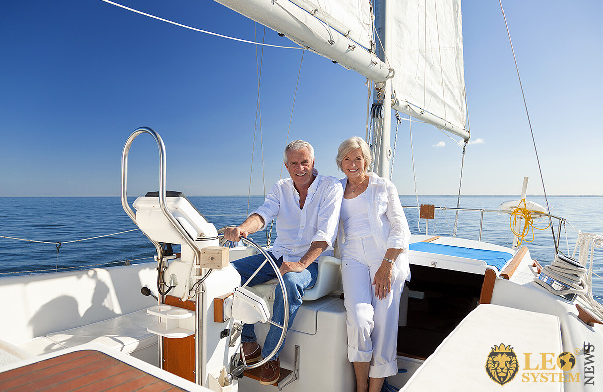Wealthy man and woman sail on a yacht