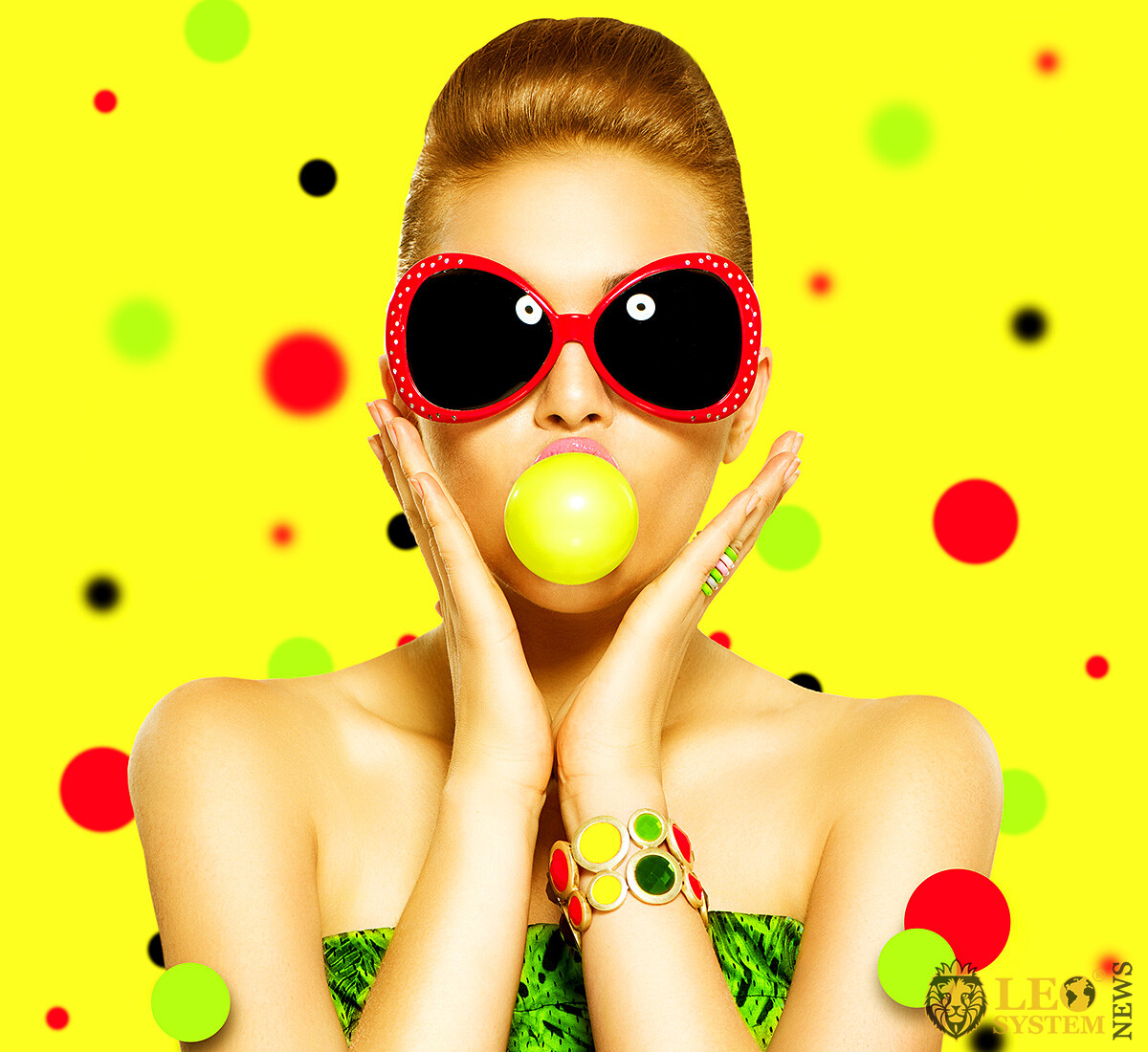 Bright woman in sunglasses and with chewing gum in her mouth
