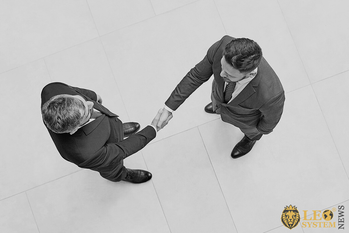 Men express their gratitude to each other and shake hands