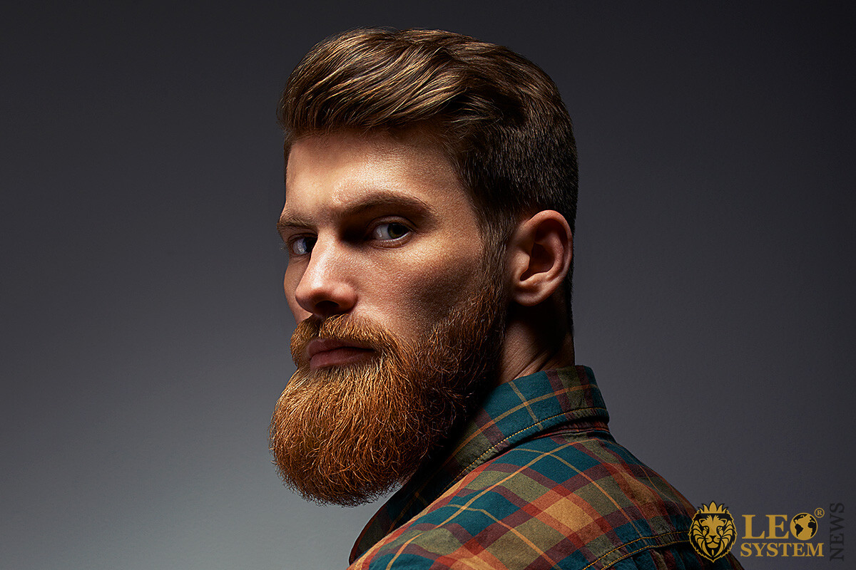 Attractive man with a large beard and a discerning look