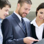 Image of a group of business people looking at documents