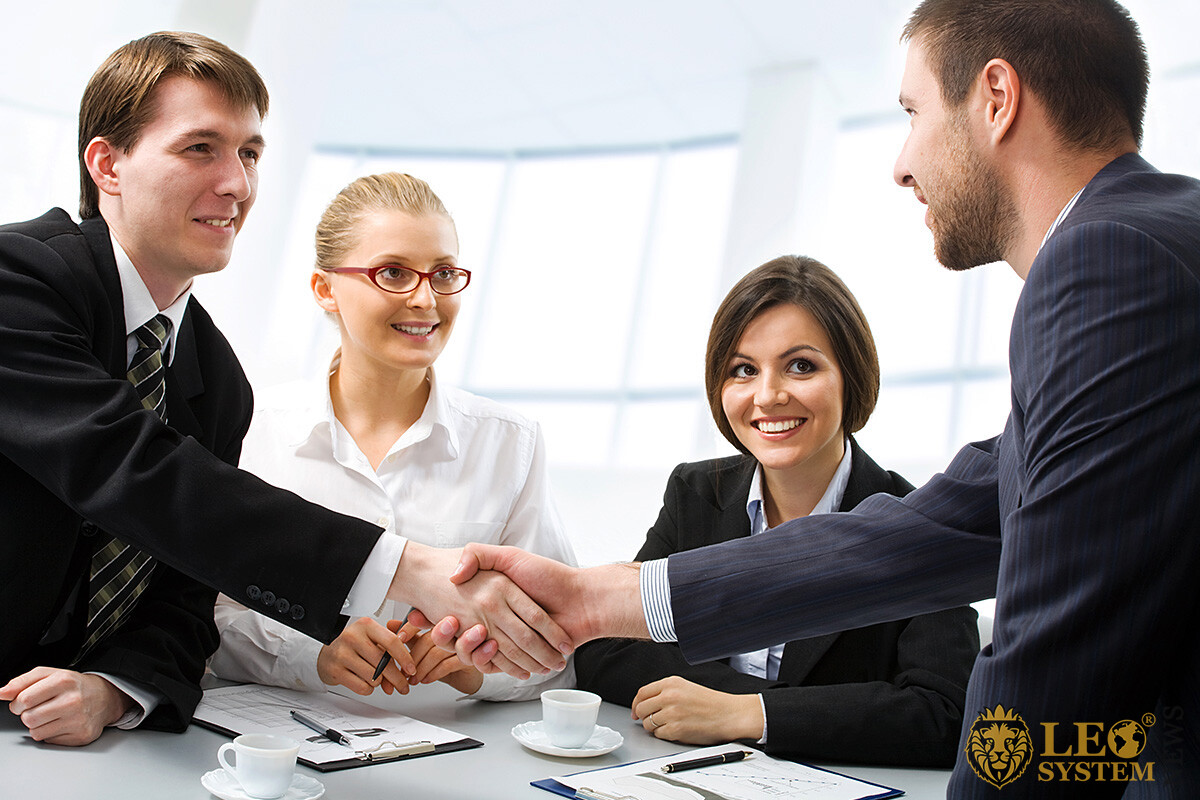 Image of a company of business people at a meeting
