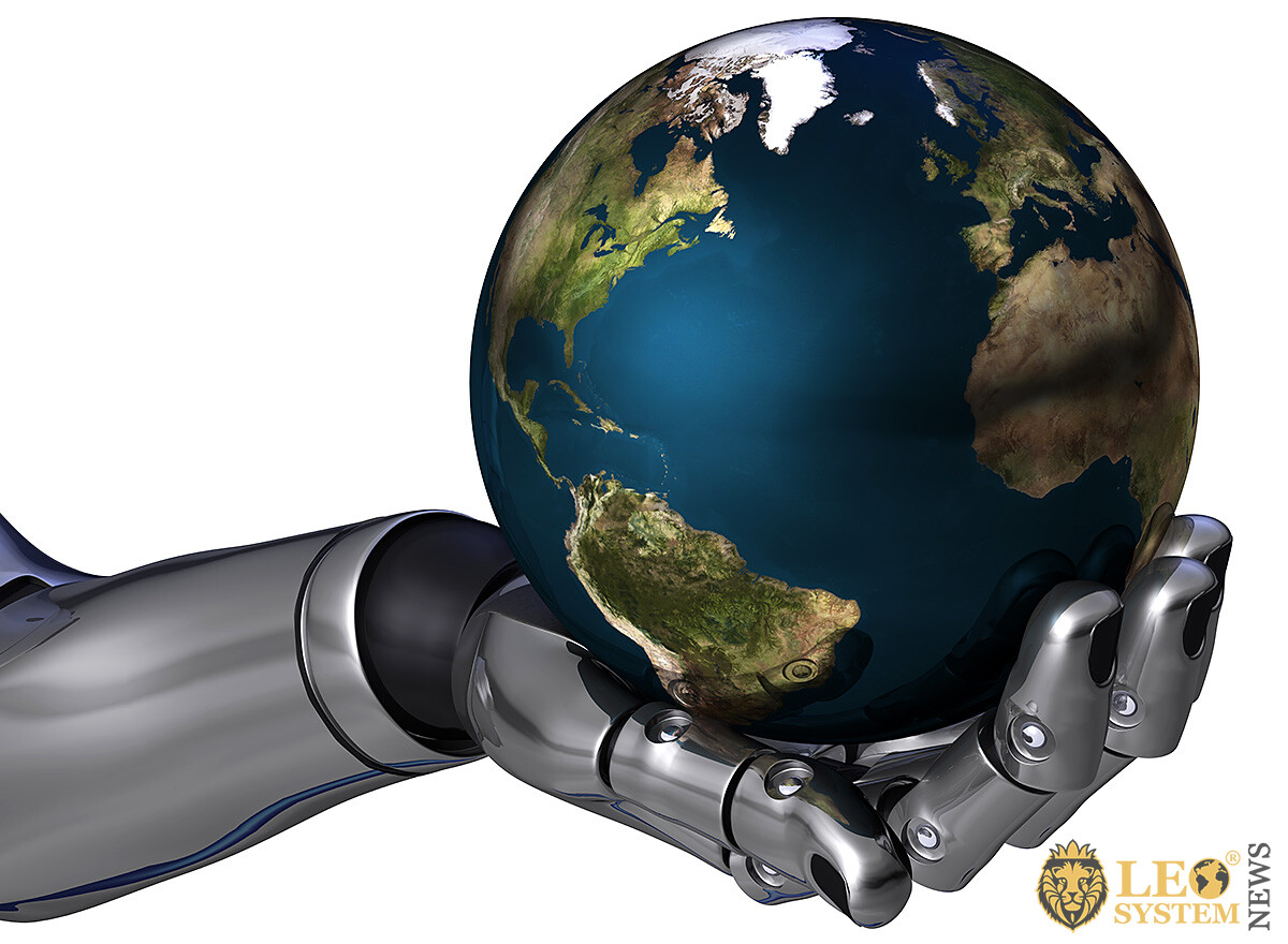 Image of a robot hand on which the globe
