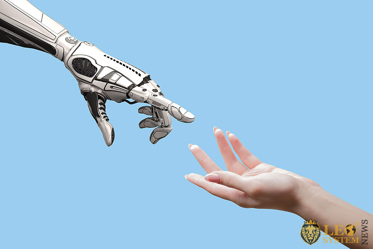 Image of a robot hand and a human
